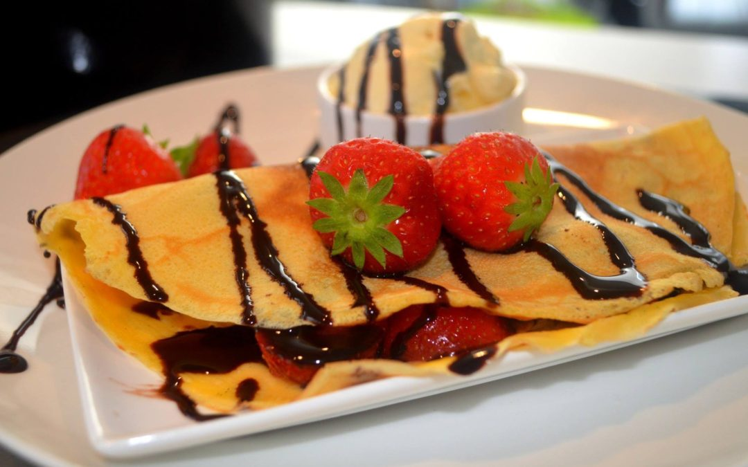 Delicious Crepes with Chocolate and Strawberry