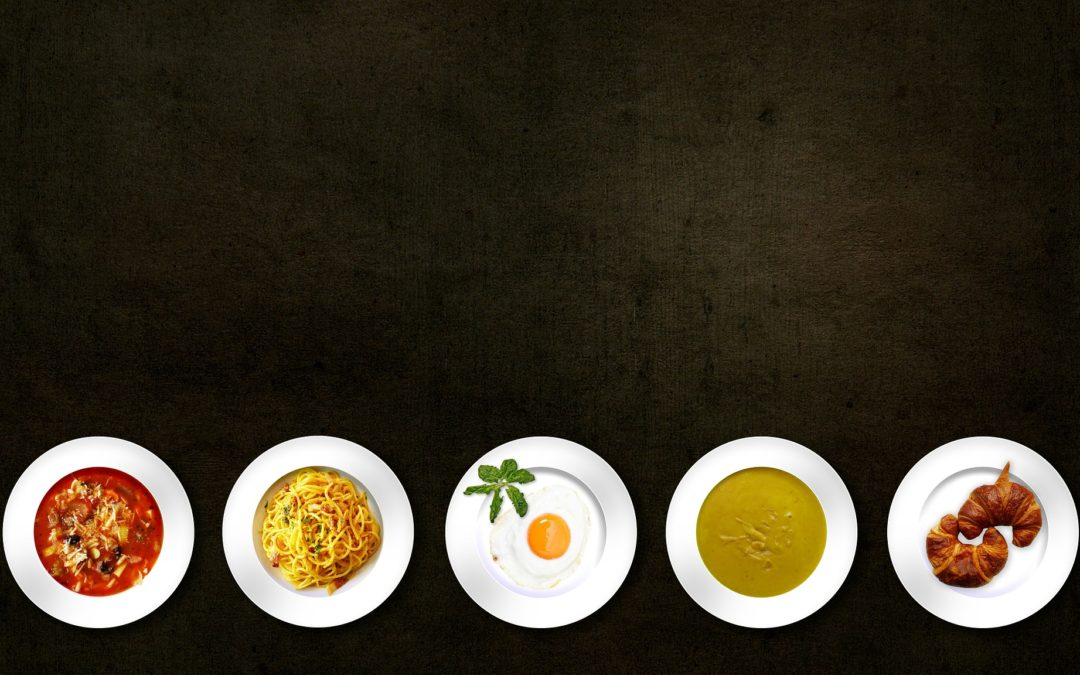 Assorted Plates of Food on Black Background Shot Overhead